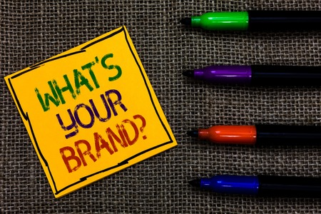 Conceptual hand writing showing What s is Your Brand question. Business photo text Define Individual trademark Identify Company Written on black lined yellow transverse note pen jute ground
