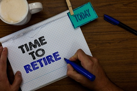 Writing note showing Time To Retire. Business photo showcasing Take the pensioner status stop working in elderly old enough Hand hold pen coffee cup blue pen paper clip stick on woody table