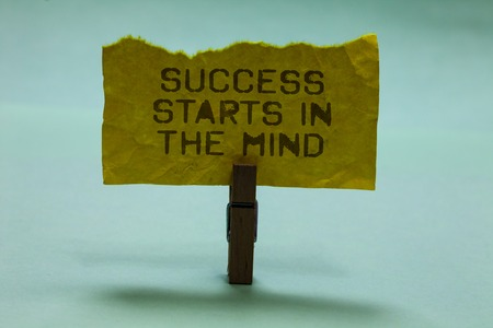 Text sign showing Success Starts In The Mind. Conceptual photo Have positive thoughts accomplish what you want Paperclip hold torn yellow page written brown words sky blue background Stock Photo