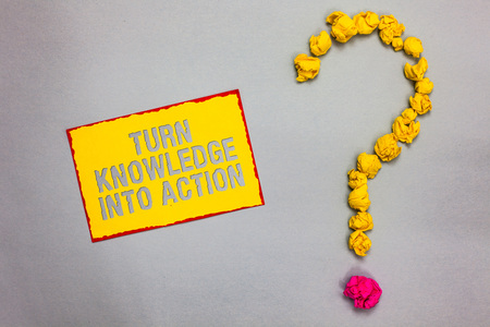 Writing note showing Turn Knowledge Into Action. Business photo showcasing Apply what you have learned Leadership strategies Red bordered yellow sticky note yellow paper lumps form question mark