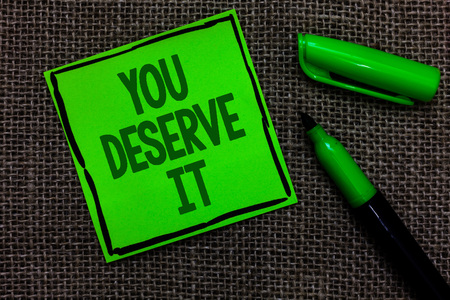 Writing note showing You Deserve It. Business photo showcasing Reward for something well done Deserve Recognition award Black lined green sticky note with words open green pen on sack