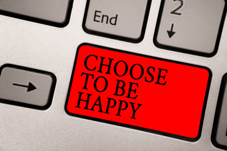 Conceptual hand writing showing Choose To Be Happy. Business photo text Decide being in a good mood smiley cheerful glad enjoy Greyish silver keyboard with red color button black color texts