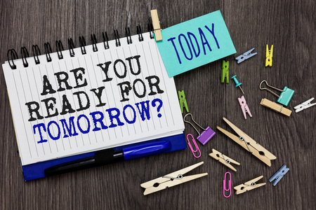 Writing note showing Are You Ready For Tomorrow question. Business photo showcasing Preparation to the future Motivation Different paperclip on woody table pinch on written notepad blue pen Stock Photo