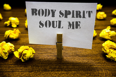 Text sign showing Body Spirit Soul Me. Conceptual photo Personal Balance Therapy Conciousness state of mind Paperclip grip white page with grey text woody floor laid blurry yellow lob Stock Photo