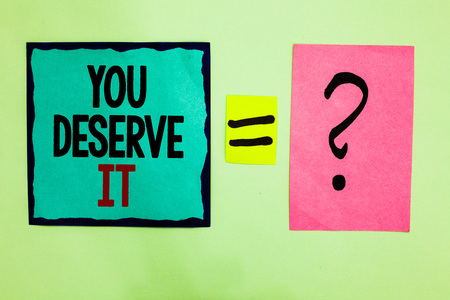 Text sign showing You Deserve It. Conceptual photo Reward for something well done Deserve Recognition award Black lined written note middle queal pink page black question mark