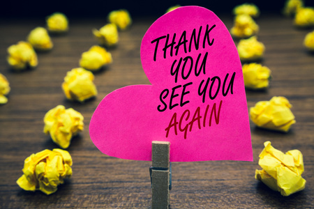 Conceptual hand writing showing Thank You See You Again. Business photo text Appreciation Gratitude Thanks I will be back soon Paperclip hold pink written heart woody floor with yellow lobs Stock fotó