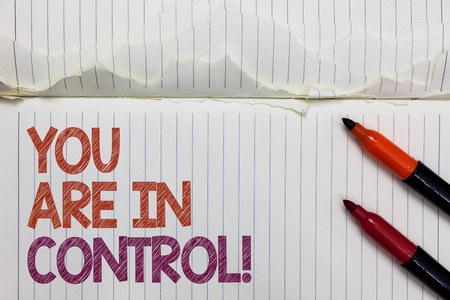 Text sign showing You Are In Control. Conceptual photo Responsibility over a situation Management authority White torn page written some letters beside laid two red marker