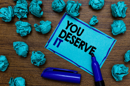 Conceptual hand writing showing You Deserve It. Business photo showcasing Reward for something well done Deserve Recognition award written blue letters on page blue marker and paper lumps