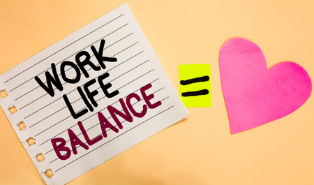 Text sign showing Work Life Balance. Conceptual photo Division of time between working or family and leisure Transverse white paper with words equal love heart on Peach color base