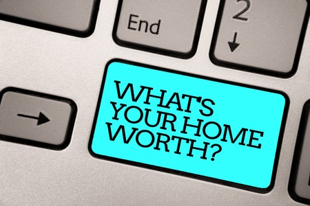 Text sign showing What s is Your Home Worth question. Conceptual photo Value of a house Property Cost Price Rate Silver grey computer keyboard with blue button black color written text