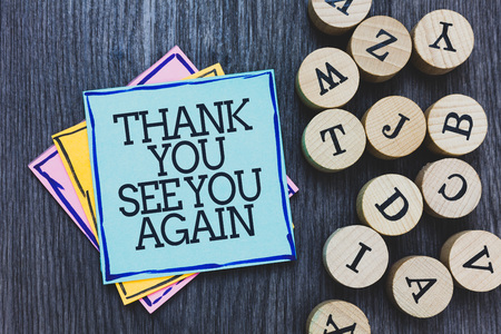 Handwriting text Thank You See You Again. Concept meaning Appreciation Gratitude Thanks I will be back soon Black wooden deck written sticky note beside some round woody alphabets