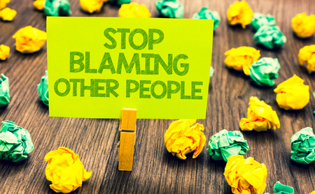 Handwriting text Stop Blaming Other People. Concept meaning Do not make excuses assume your faults guilt Paperclip retain written words yellow paper paper lobs laid on wooden floor