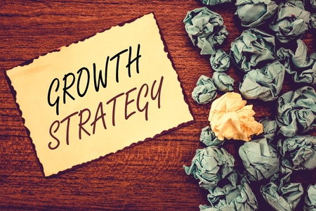 Word writing text Growth Strategy. Business concept for Strategy aimed at winning larger market share in shortterm.