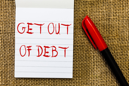 Handwriting text Get Out Of Debt. Concept meaning No prospect of being paid any more and free from debt.