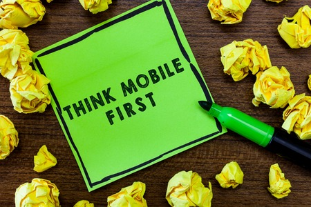 Text sign showing Think Mobile First. Conceptual photo Easy Handheld Device Accessible Contents 24 or 7 Handy. Stock Photo
