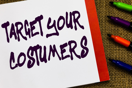 Handwriting text Target Your Costumers. Concept meaning Specific Range and Interest Potential Users and Buyers Open notebook page jute background colorful markers Expressing ideas Banque d'images - 108737892