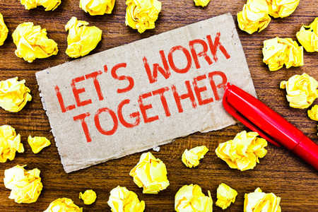 Text sign showing Let s is Work Together. Conceptual photo Unite and Join Forces to Achieve a Common Goal. Stock Photo