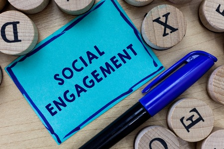 Conceptual hand writing showing Social Engagement. Business photo text Degree of engagement in an online community or society.
