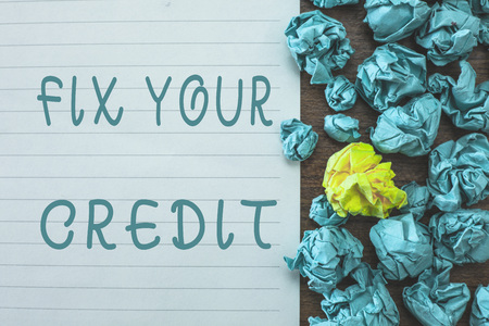 Conceptual hand writing showing Fix Your Credit. Business photo text Keep balances low on credit cards and other credit. Stockfoto