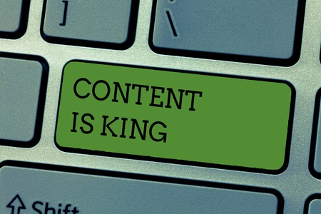 Writing note showing Content Is King.