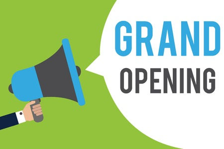 Text sign showing Grand Opening. Conceptual photo Ribbon Cutting New Business First Official Day Launching Man holding megaphone loudspeaker speech bubble message speaking loud Stock Photo