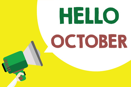 Conceptual hand writing showing Hello October. Business photo text Last Quarter Tenth Month 30days Season Greeting Man holding megaphone loudspeaker speech bubble yellow background
