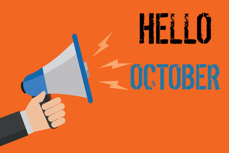 Conceptual hand writing showing Hello October. Business photo text Last Quarter Tenth Month 30days Season Greeting Man holding loudspeaker orange background message speaking loud Stock Photo