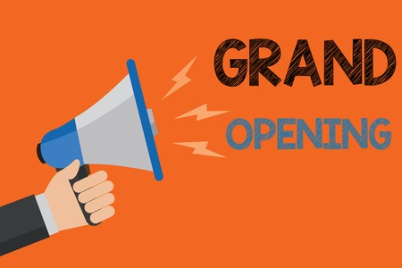 Conceptual hand writing showing Grand Opening. Business photo text Ribbon Cutting New Business First Official Day Launching Man holding loudspeaker orange background message speaking loud Stock Photo