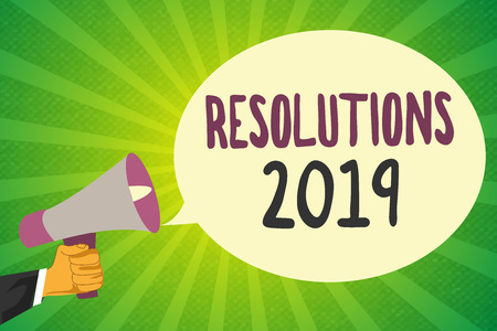 Handwriting text writing Resolutions 2019. Concept meaning list of things wishes to be fully done in next year.