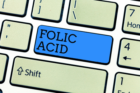 Handwriting text writing Folic Acid. Concept meaning Vitamin required for normal production of red blood cells.