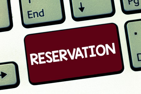 Handwriting text Reservation. Concept meaning Arrangement made so a seat somewhere is kept for someone. Archivio Fotografico