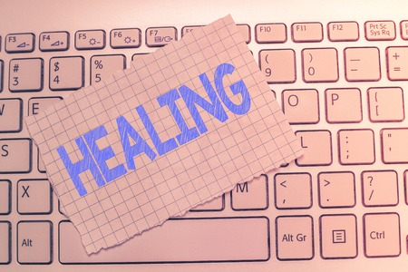 Writing note showing Healing. Business photo showcasing process of making or becoming sound or healthy again Helping injured. Foto de archivo - 110296864