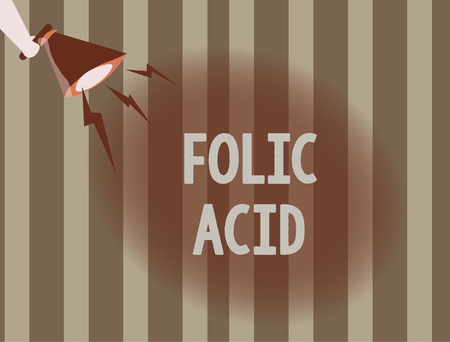 Text sign showing Folic Acid. Conceptual photo Vitamin required for normal production of red blood cells. 写真素材