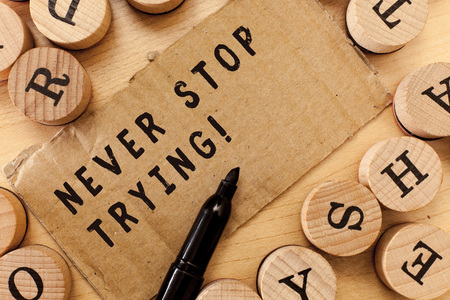 Handwriting text writing Never Stop Trying. Concept meaning Do not give up Continue to Try Again Keep on Doing.