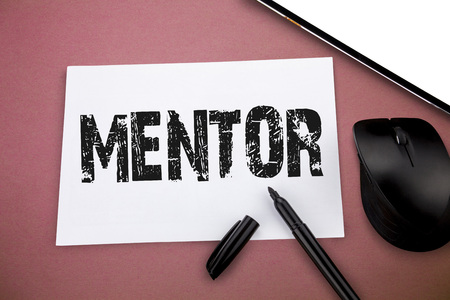Writing note showing Mentor. Business photo showcasing advise or train someone especially younger colleague trusted adviser.