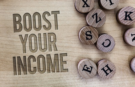 Conceptual hand writing showing Boost Your Income. Business photo showcasing Increase your money Investment Freelancing Trading.