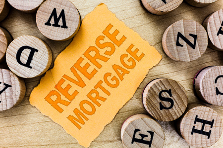 Handwriting text Reverse Mortgage. Concept meaning loan for seniors age above sixties and older to be returned.