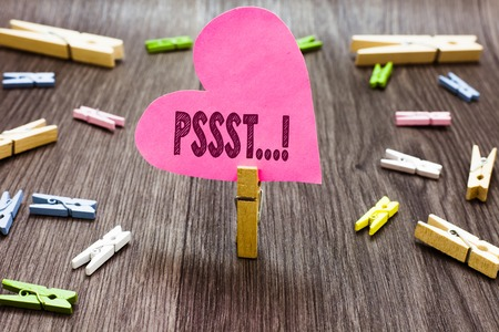 Writing note showing Pssst.... Business photo showcasing Expression Way to attract attention of someone Be quiet Silence Clothespin holding pink paper heart several clothespins wooden floor