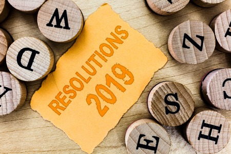 Handwriting text Resolutions 2019. Concept meaning list of things wishes to be fully done in next year. Banco de Imagens