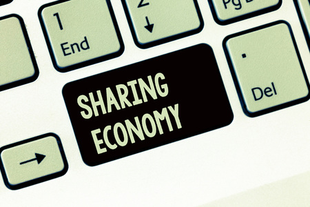 Handwriting text writing Sharing Economy. Concept meaning economic model based on providing access to goods . Banque d'images - 110764391