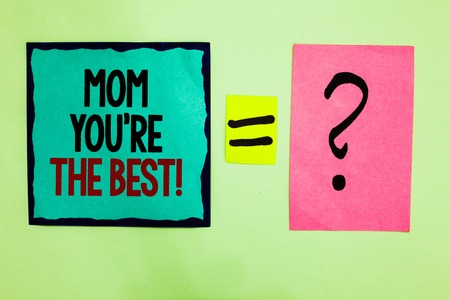 Text sign showing Mom You re are The Best. Conceptual photo Appreciation for your mother love feelings compliment Black lined written note middle queal pink page black question mark Stock Photo