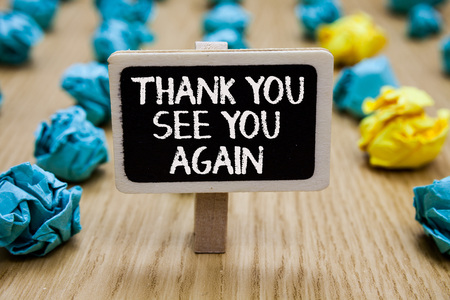 Text sign showing Thank You See You Again. Conceptual photo Appreciation Gratitude Thanks I will be back soon Paperclip hold written chalkboard behind paper lumps on woody deck