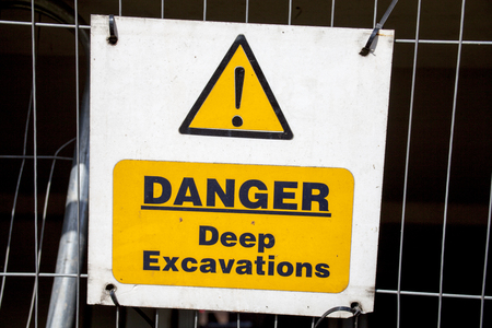 A warning sign telling people of deep excavation Stok Fotoğraf