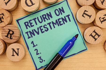 Handwriting text Return On Investment. Concept meaning Ratio between the Net Profit and Cost invested.