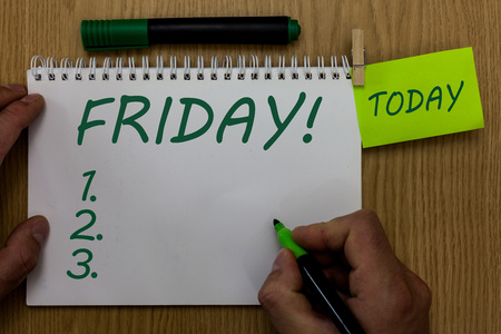 Text sign showing Friday. Conceptual photo Last day of working week Start weekend Relax time Holiday leisure Man holding marker notebook clothespin reminder wooden table cup coffee