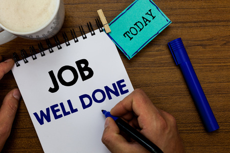 Writing note showing Job Well Done. Business photo showcasing Well Performed You did it Cheers Approval Par Accomplished Man holding marker notebook clothespin reminder wooden table coffee