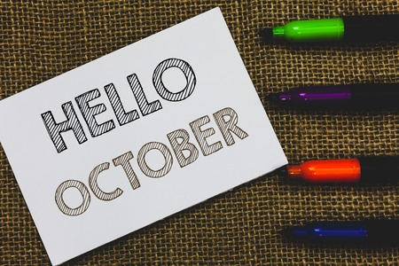 Handwriting text Hello October. Concept meaning Last Quarter Tenth Month 30days Season Greeting White Paper Important reminder Communicate ideas Markers Jute background