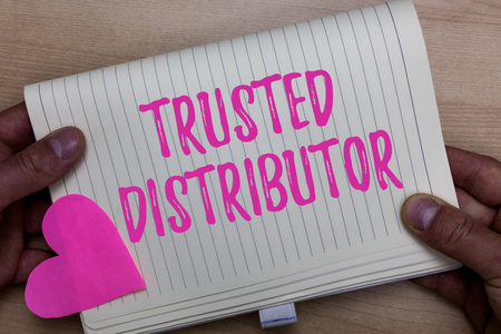 Writing note showing Trusted Distributor. Business photo showcasing Authorized Supplier Credible Wholesale Representative Man holding notebook paper heart Romantic ideas Wooden background