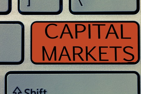 Writing note showing Capital Markets. Business photo showcasing Allow businesses to raise funds by providing market security. Stock Photo