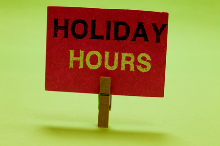 Text sign showing Holiday Hours. Conceptual photo Schedule 24 or 7 Half Day Today Last Minute Late Closing Clothespin holding red paper important communicating messages ideas